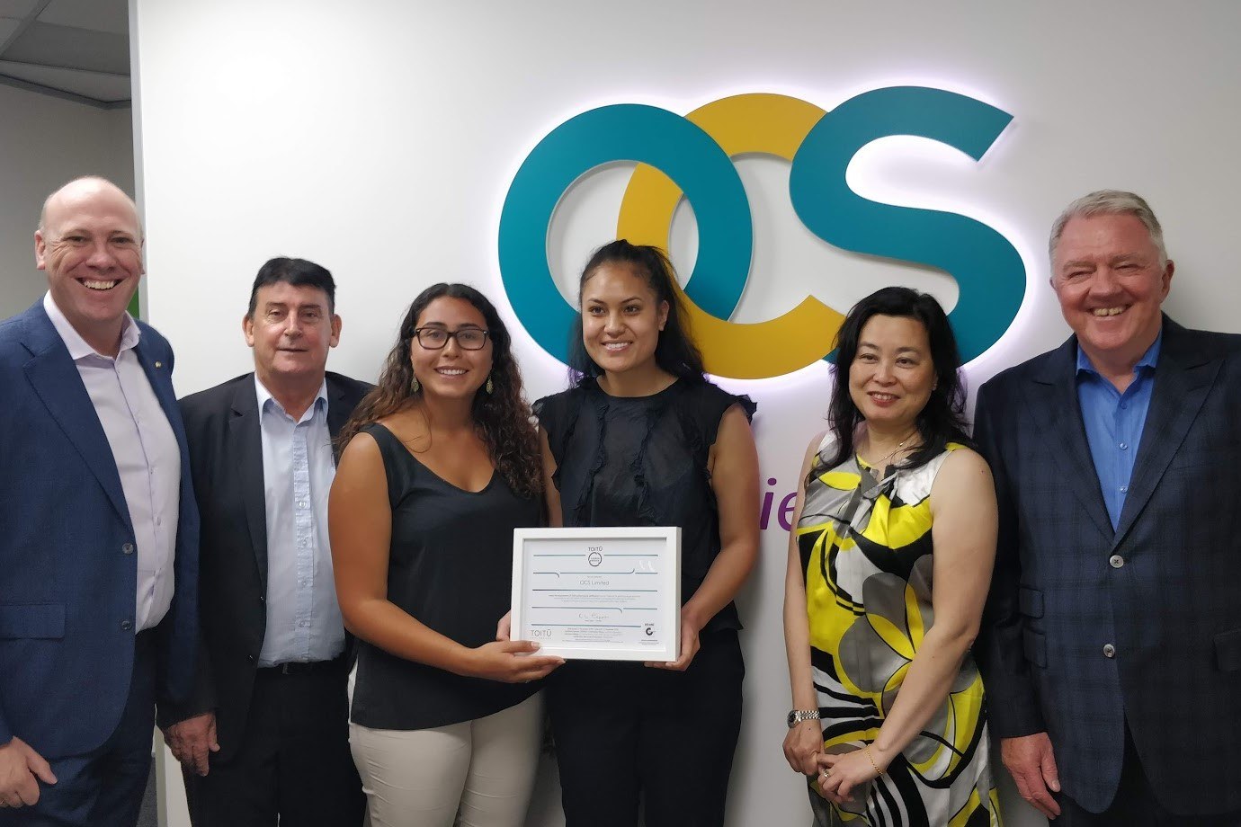 OCS team celebrating their Toitū carbonzero certification