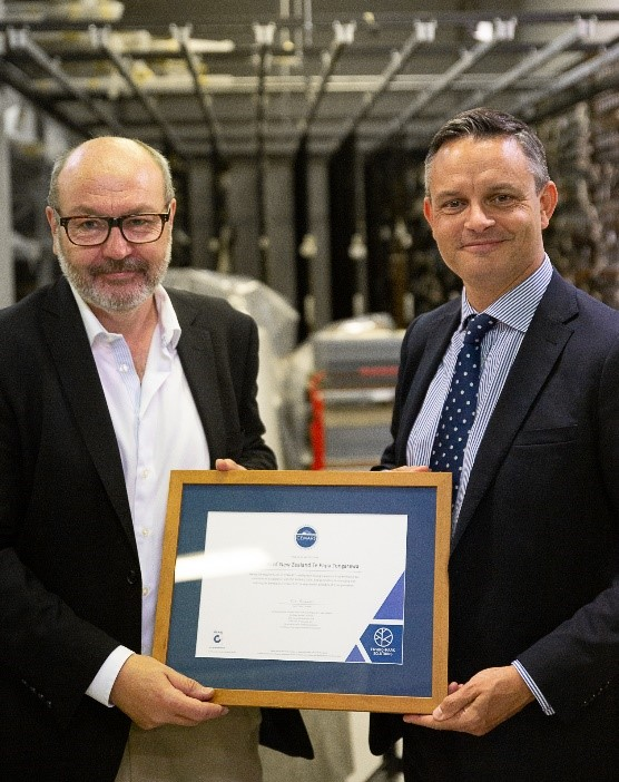 Te Papa CEO Geraint Martin, presented with Te Papa's first CEMARS certificate by Minister for Climate Change James Shaw.