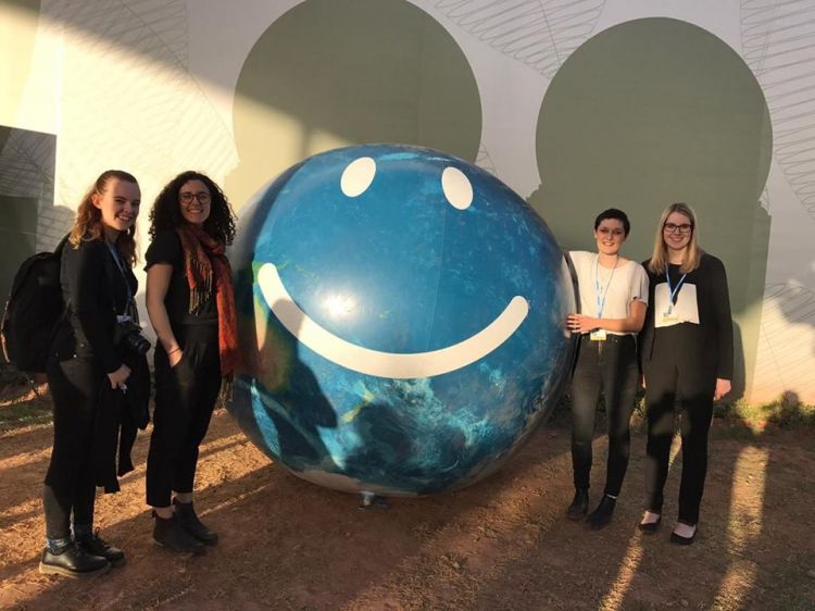Youth delegates and the iconic 'happy world'
