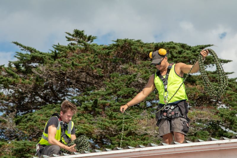 The Marae DIY solar installers set up safety gear to work on the roof install